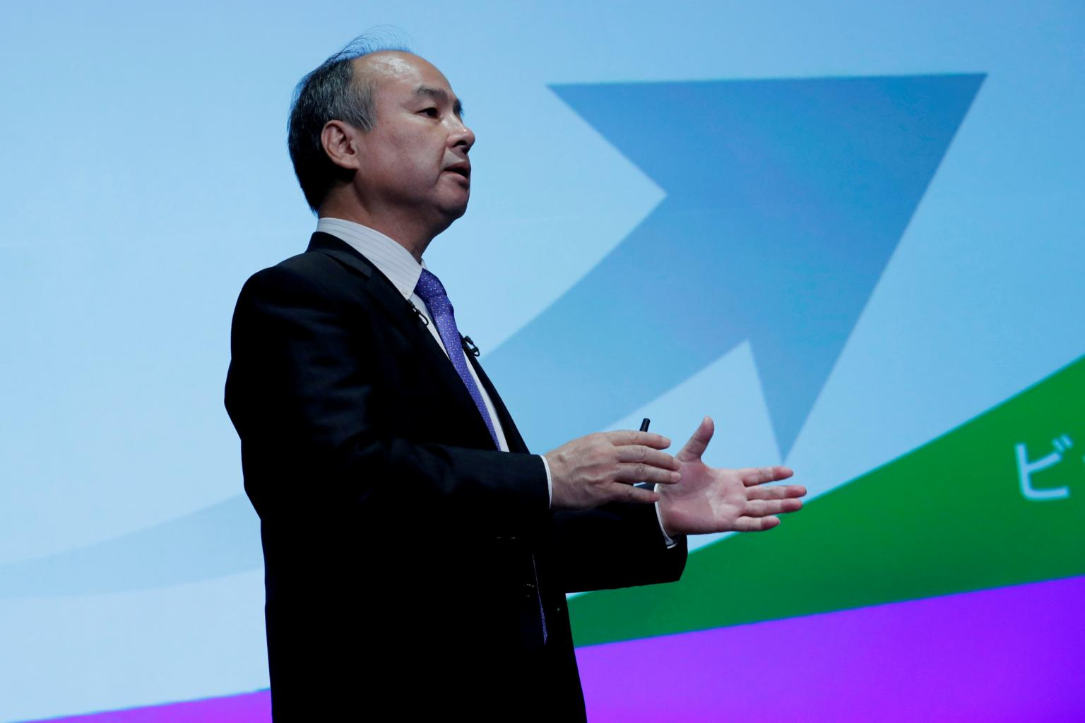 SoftBank's Son is 'embarrassed' by record, impatient to improve, -