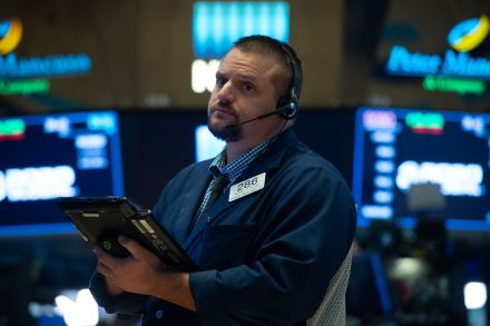 Stocks lose ground on hectic day