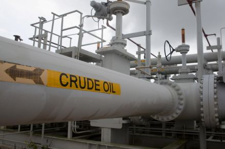 Oil edges up to $42 after slide, but glut still weighs