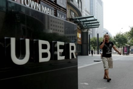 39284093 - 01_08_2016 - CHINA-US-TRANSPORT-UBER-DIDI-MERGER.jpg