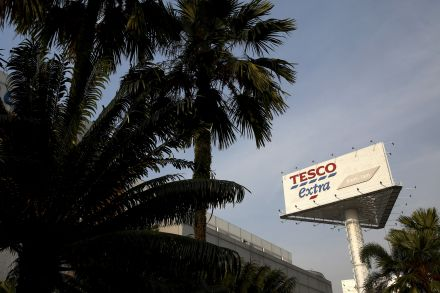 UK fraud office charges 3 over Tesco profits overstatement
