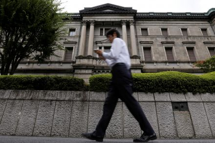 BOJ keeps policy steady, cuts price forecast