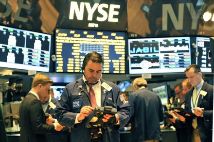 Stock indexes up as dollar holds flat before Fed