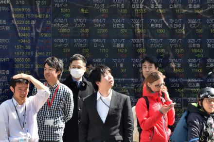 Asian markets end lower