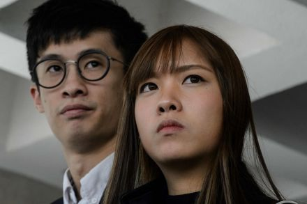 Hong Kong police arrest two disqualified lawmakers - party