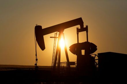 Oil prices slide amid glut concerns, U.S.  withdrawal from climate deal