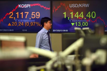 Growth worries push stocks lower, Fed hike lifts dollar