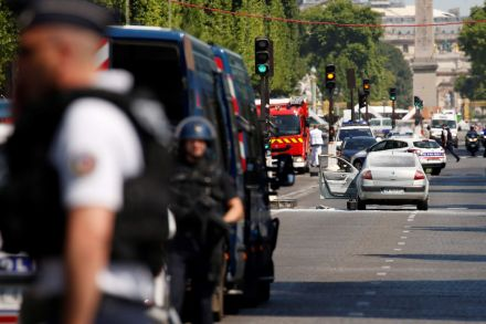Vehicle rams police van on Champs-Elysees, armed suspect dead