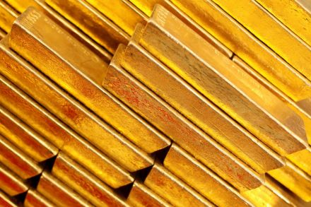 Gold, silver futures settle higher
