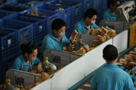 China Oct factory output growth slows, retail sales miss expectations