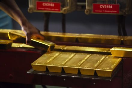 Gold dips on firmer dollar but stays close to 1-month peak