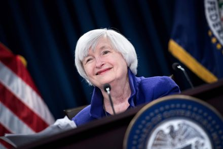Dow notches record close after Fed hikes rates