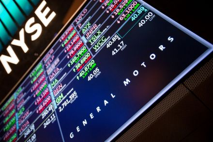 Volatile Dow closes up 567 points on day of sharp swings