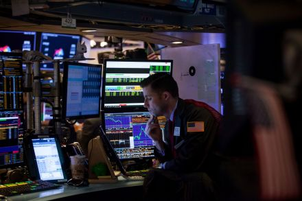 Wall Street tumbles on trade war fears; tech, financials weigh