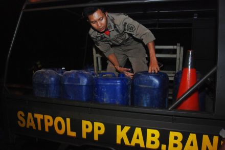 Image result for Dozens dead in Indonesia after drinking bootleg liquor