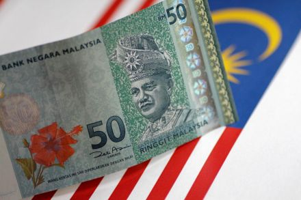 Mahathir says ringgit's fair value is 3 8 to US dollar, same as Asia