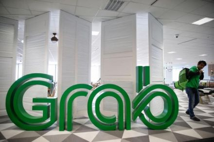 Singapore says Uber may have to unwind merger with Grab