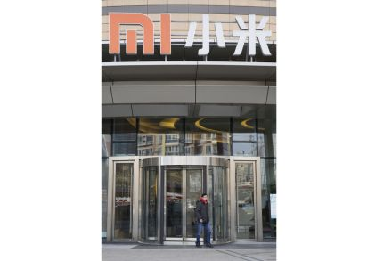 Smartphone maker Xiaomi's shares open 2.9 percent down on debut in HK