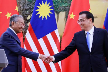 Mahathir tones down anti-China rhetoric during visit to Beijing
