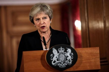 May tells ministers to hold their nerve