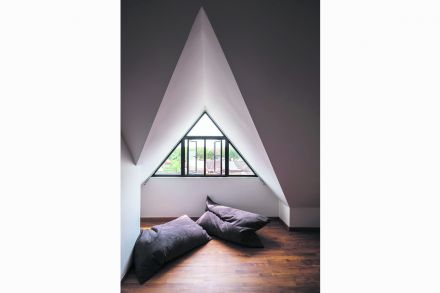 The pitched roof in the guest room gives the space a lofty feel.jpg