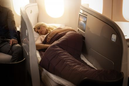 Air New Zealand_7879 Dreamliner_Business Premier_Lie Flat Bed with Lady Sleeping_1500x1000.jpg