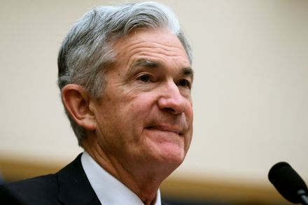 Powell sees potential threats from global slowdown