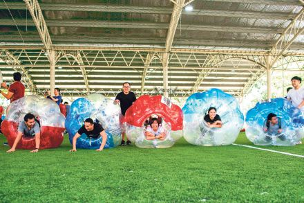 08-11 Cover Story Folder-Links-DP Architect employees playing BubbleSoccer.jpg