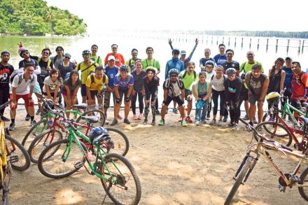 08-11 Cover Story Folder-Links-DP Architects staff cycling in Pulau Ubin.jpg