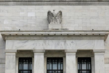 Markets slump after Fed hikes rates