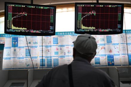 China stocks, currency weaker on trade war escalation, state buying seen