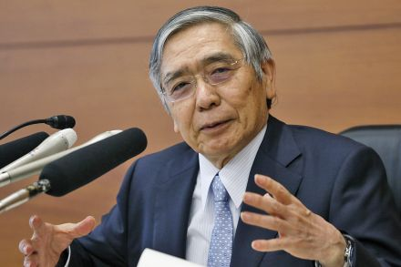 BOJ stands pat, trims inflation outlook