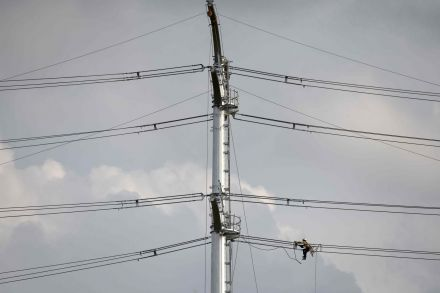 A lineman works on an electricity power transmission line in Ampang in the suburbs of Kuala Lumpur, Malaysia.