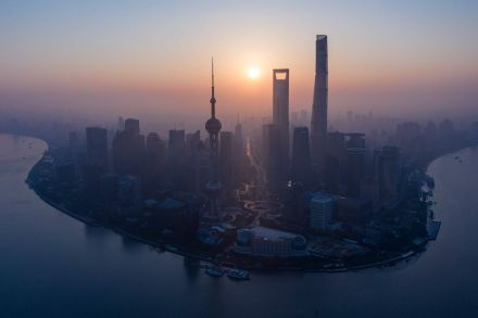 Sunrise over Shanghai's financial district.