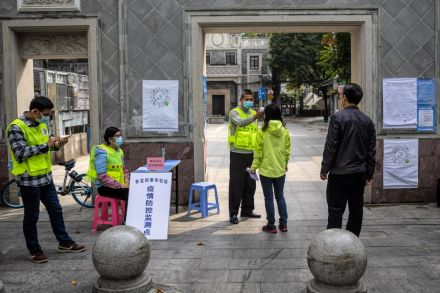 China's coronavirus death toll surpasses 1400, but fewer new cases