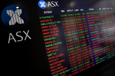 Australia cuts benchmark interest rate to record low 0.25%