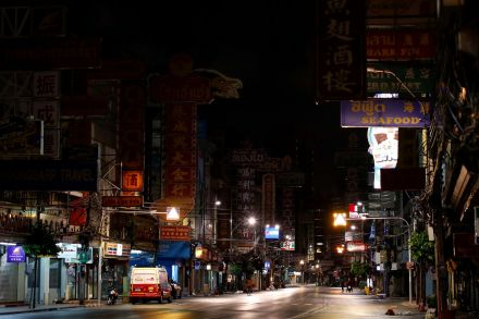 The neon signs have been turned off on Yaowarat Road in Bangkok's Chinatown, as a nationwide curfew is imposed to curb the Covid-19 outbreak.