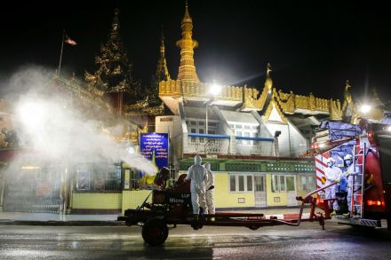 Disinfectant is sprayed on the streets of Yangon to curb the spread of Covid-19.