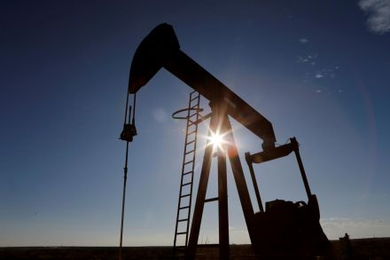Oil down with estimate of large USA crude stock buildup