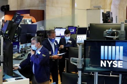 Nasdaq closes at new record high but S&P, Dow lower
