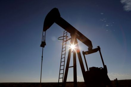 Oil rises as Int'l Energy Agency boosts demand forecast
