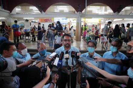 WP candidates for Aljunied GRC Pritam Singh; Leon Perera; Gerald Giam; and Faisal Manap at a media doorstop and walkabout at 209 Kovan Hawker Centre on July 8, 2020. ST - Jason Quah.jpg
