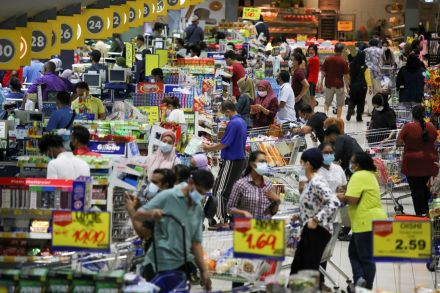 Supermarket queues form in Subang Jaya, Selangor, after the announcement of renewed movement restrictions.