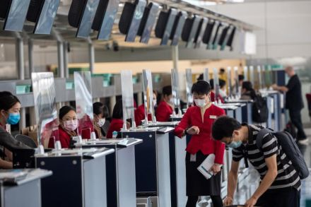 Cathay Pacific check-in counters at HK airport - EPA.jpg