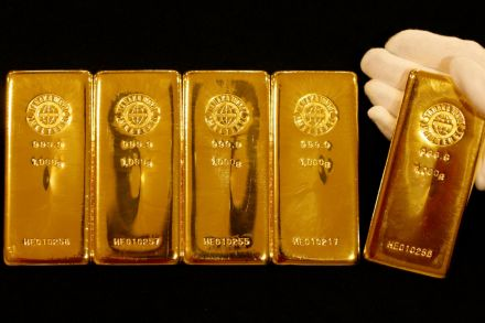 Gold ticks higher as weak U.S