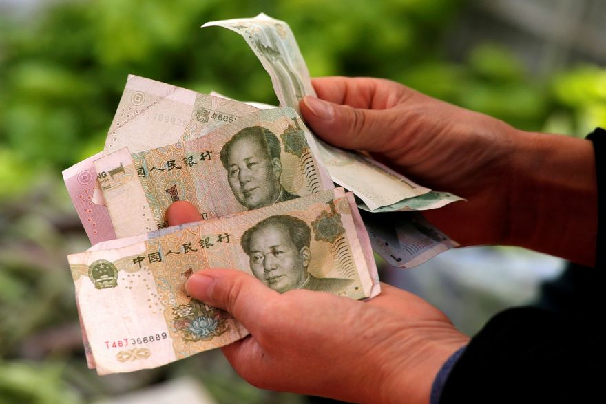 China's yuan steady, central bank strengthens defence ahead of Q2 GDP, Government & Economy - THE BUSINESS TIMES