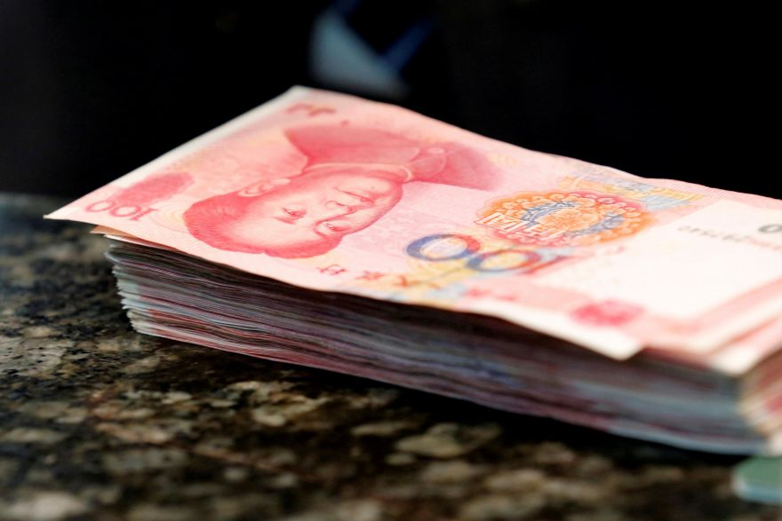 China's yuan firms as companies cover short positions, Banking & Finance - THE BUSINESS TIMES