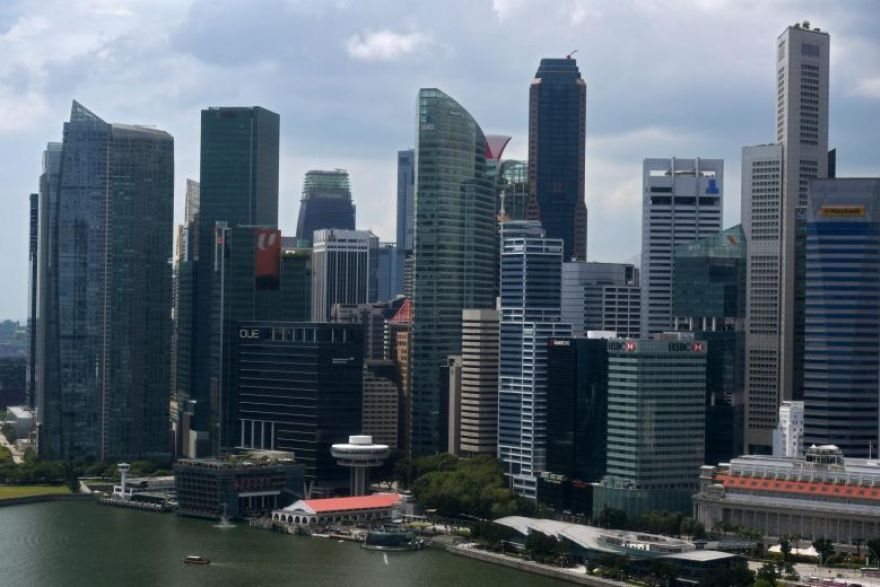Singapore clings on to third place in FX trading race, survey finds,