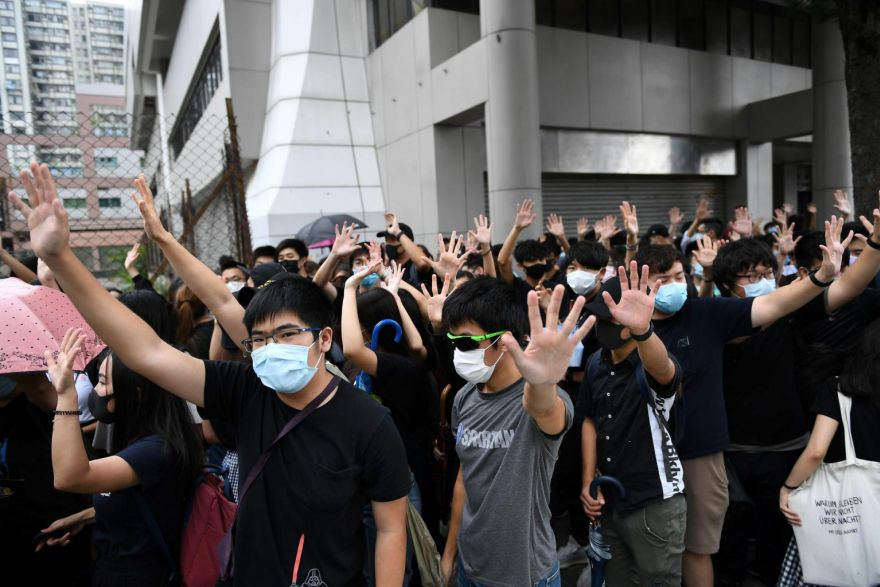 First Hong Kongers appear in court for defying mask ban, - THE