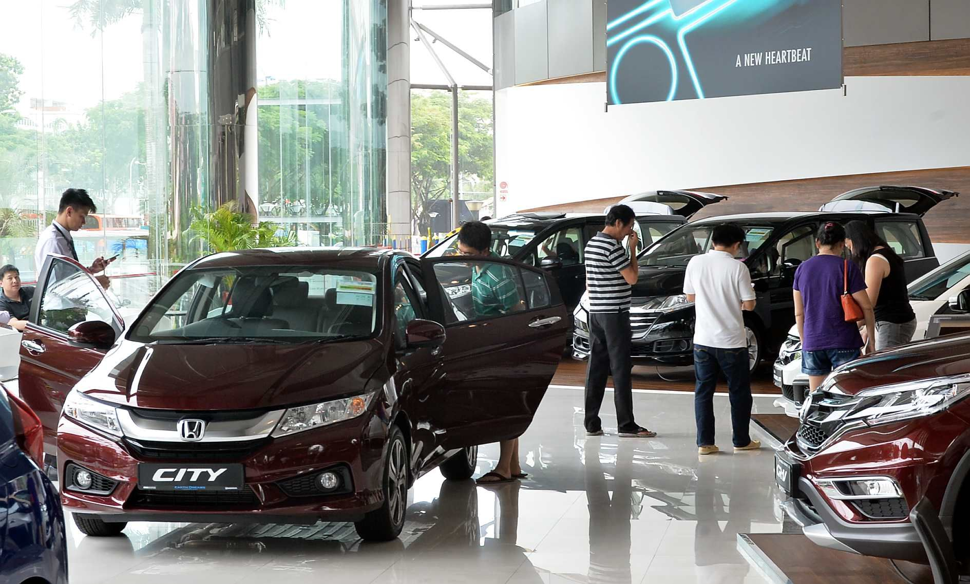 COEs end mostly lower as Uber sells stock of unused cars, Transport ...